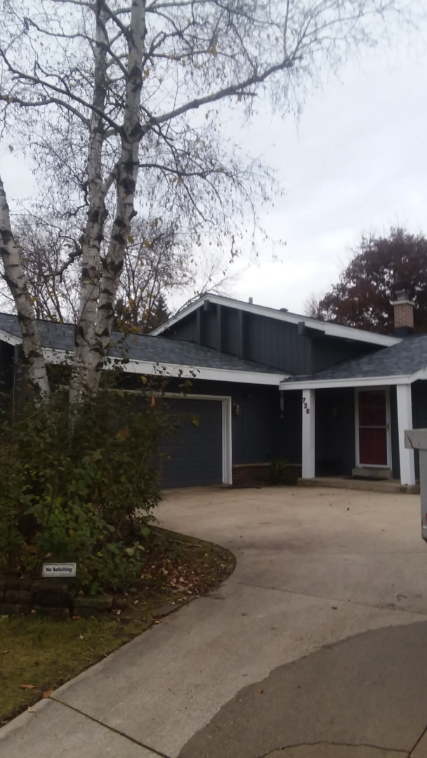 Waukesha, WI - Installing gutters  on ranch house