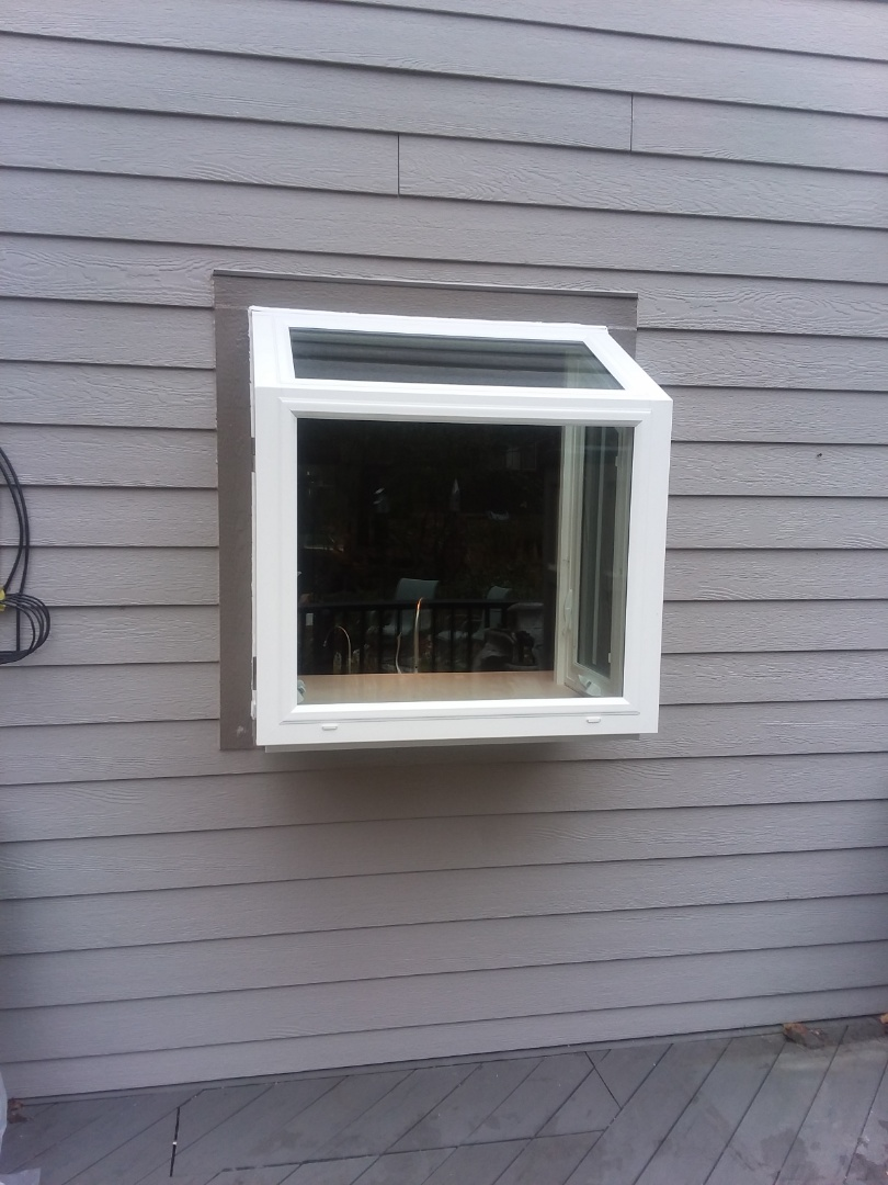 Waukesha, WI - One garden window full frame with woodwork and aluminum trim