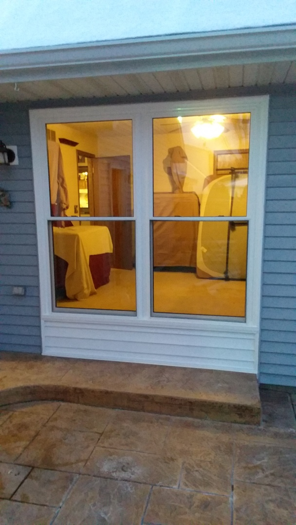 Oconomowoc, WI - 3 double hung windows and a patio door