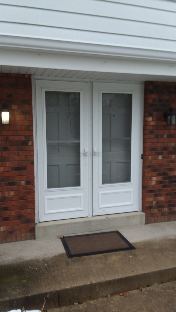 Franklin, WI - Entry door, before