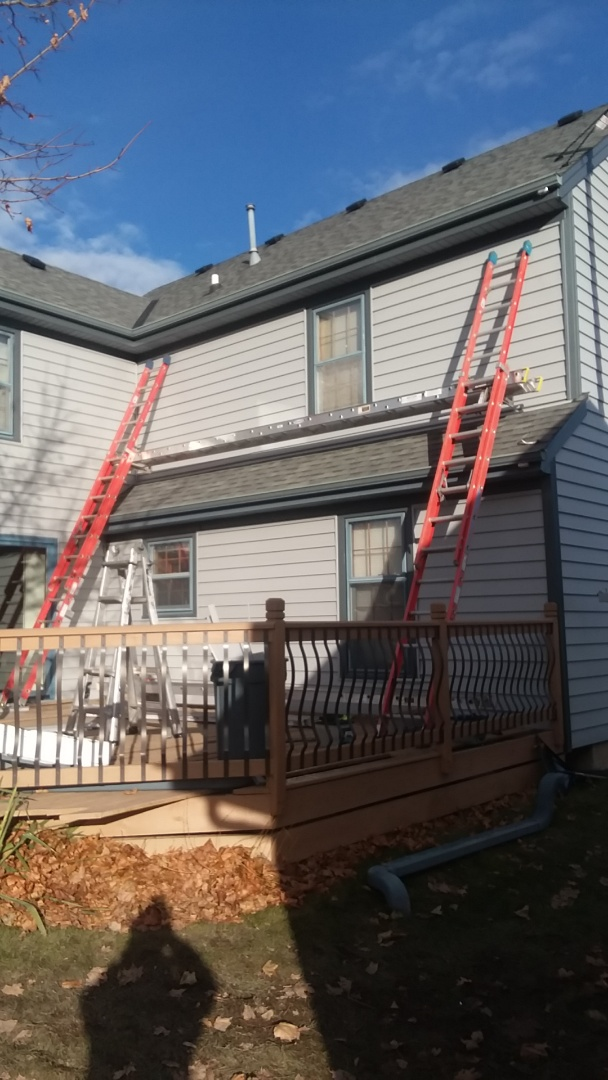 New Berlin, WI - Continuing installing vinyl siding on back of 2 story home