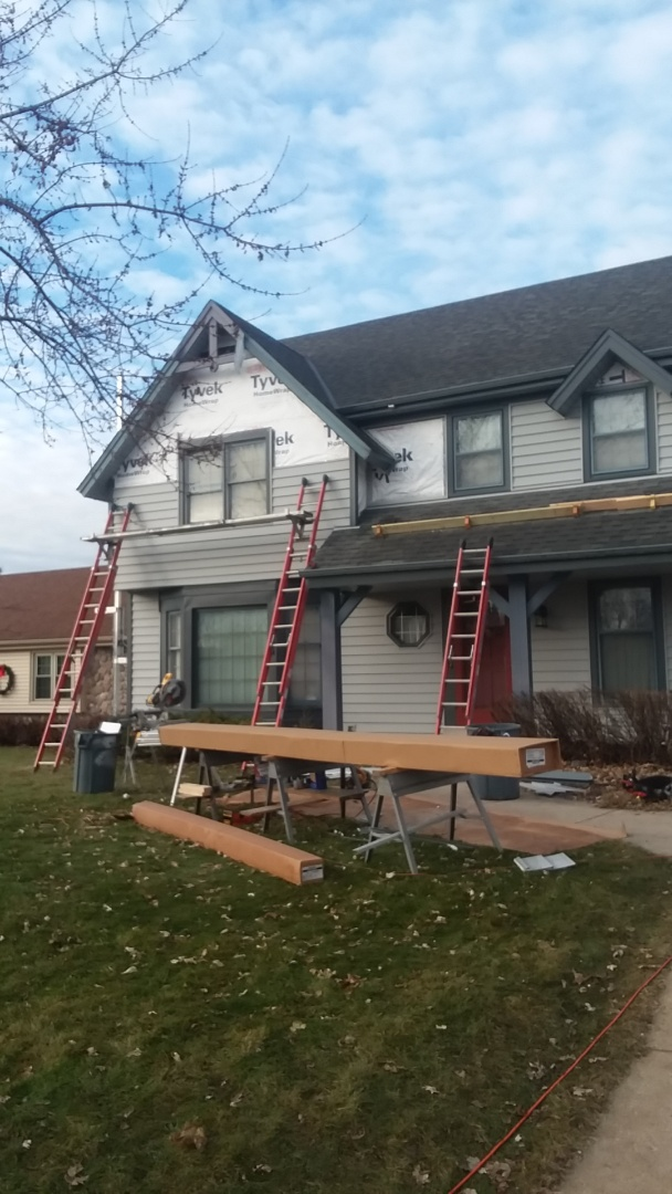 New Berlin, WI - Finishing siding and trim on front of house