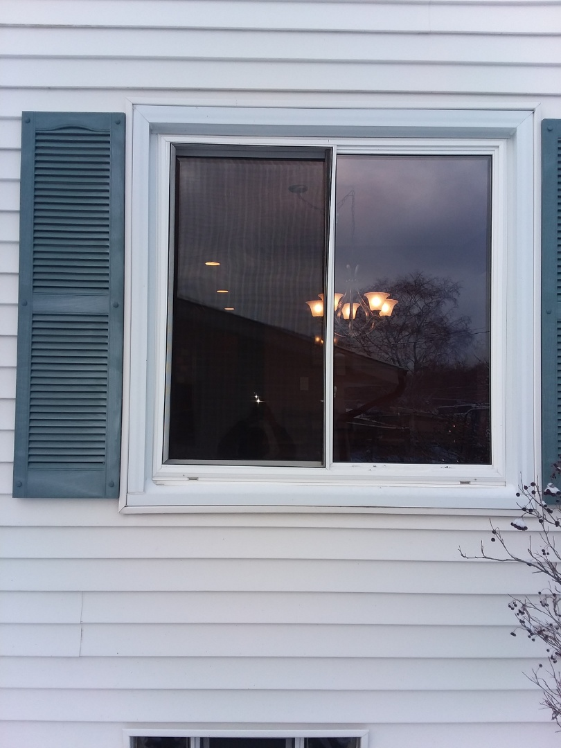 New Berlin, WI - One window full frame with woodwork and aluminum trim