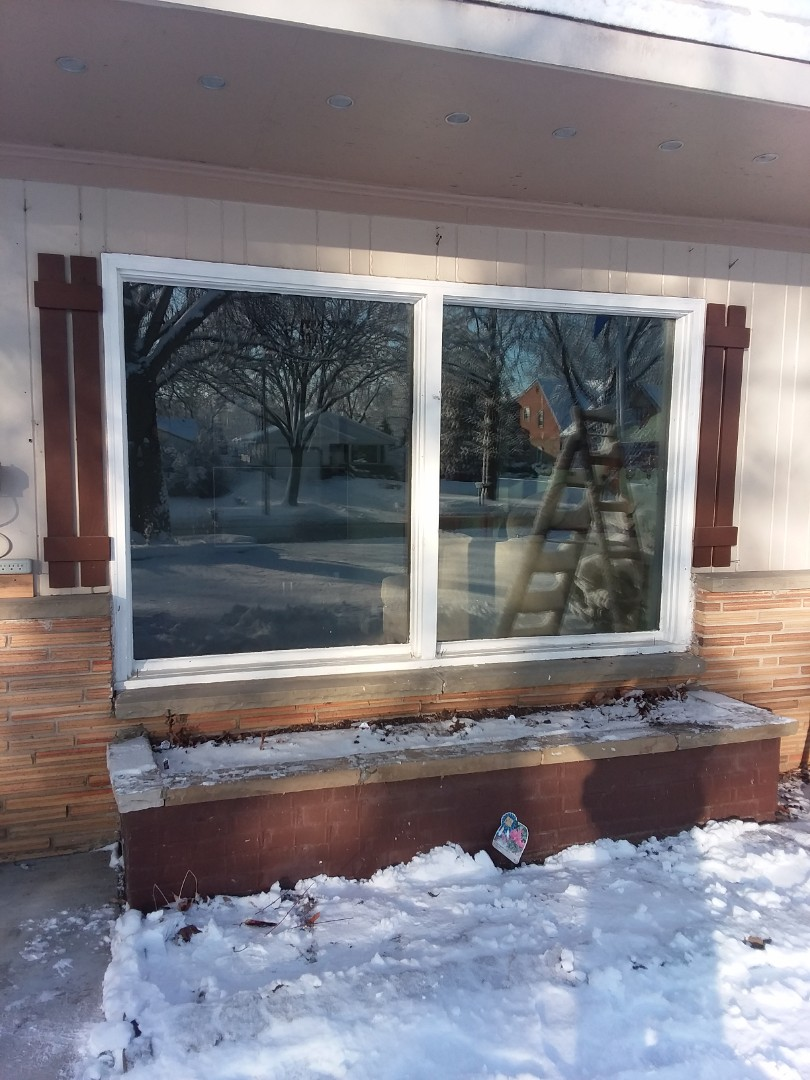Wauwatosa, WI - One window full frame with vinyl brickmold and woodwork