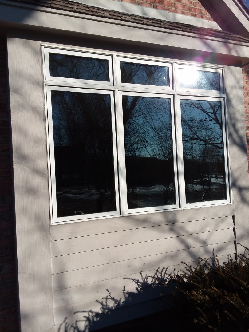 Greenfield, WI - Two windows full frame with woodwork and aluminum trim