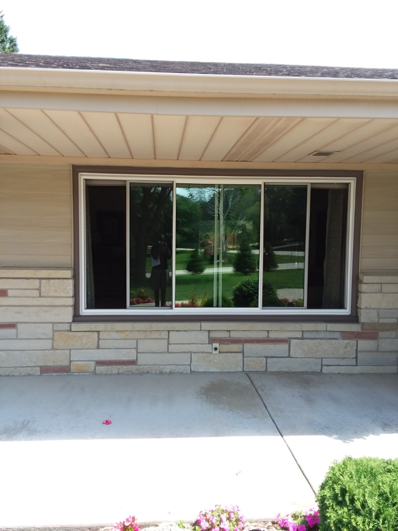 New Berlin, WI - Five windows and a door with woodwork and aluminum trim