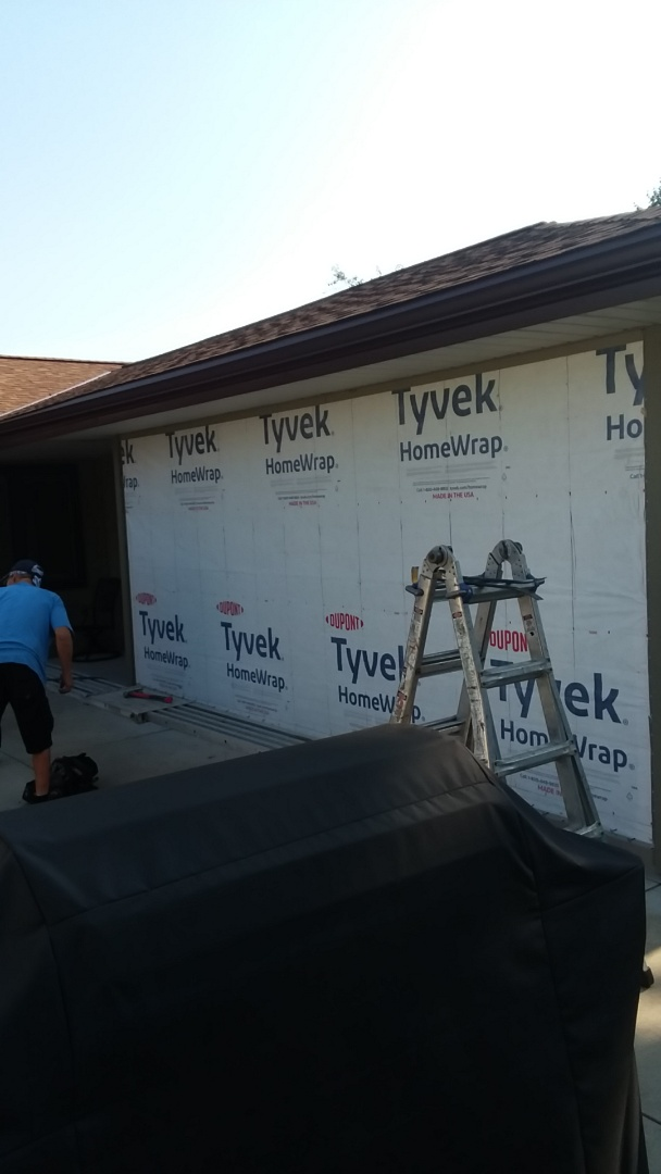 Milwaukee, WI - Servicing siding on back of grage