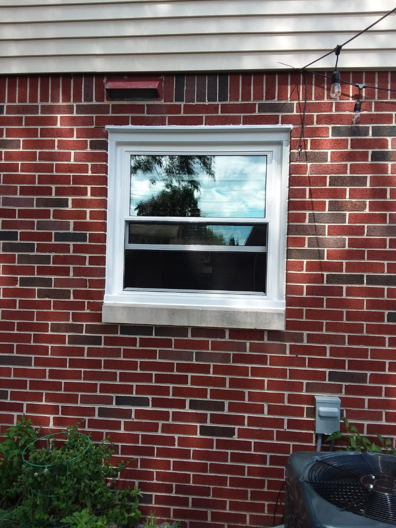 Wauwatosa, WI - One window full frame with woodwork and aluminum trim
