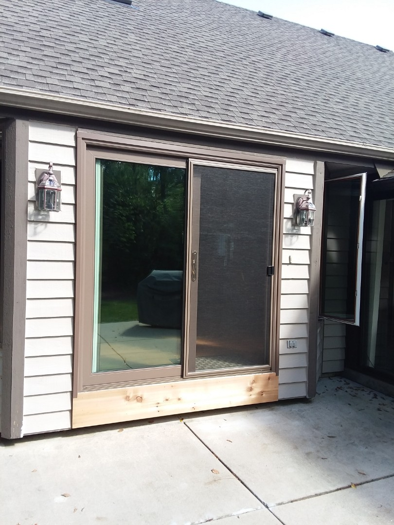 Muskego, WI - Patio door and two full frame with vinyl brick mold and wood work