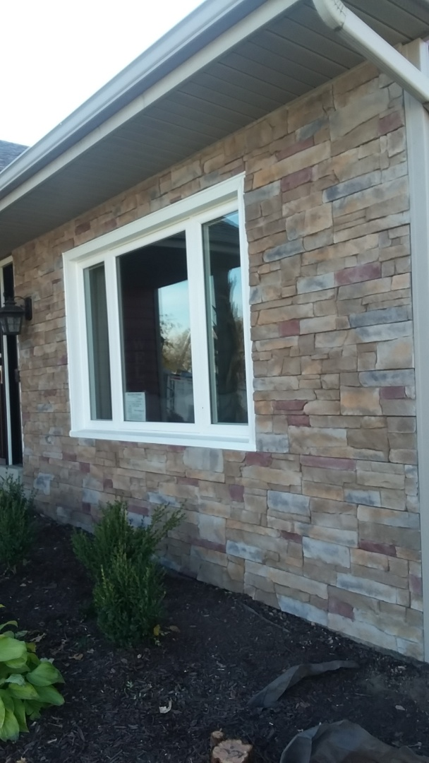 Franklin, WI -  installing certainteed stone siding on front of house