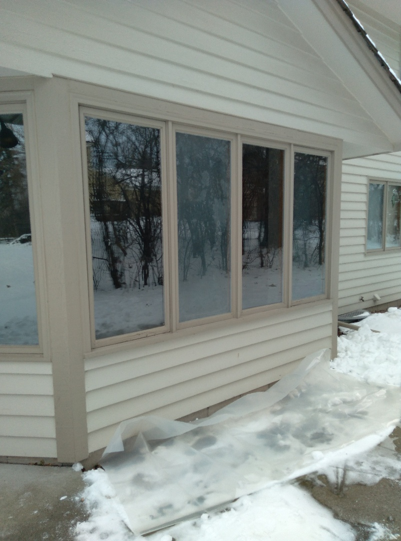New Berlin, WI - One window full frame with woodwork and vinyl brickmold