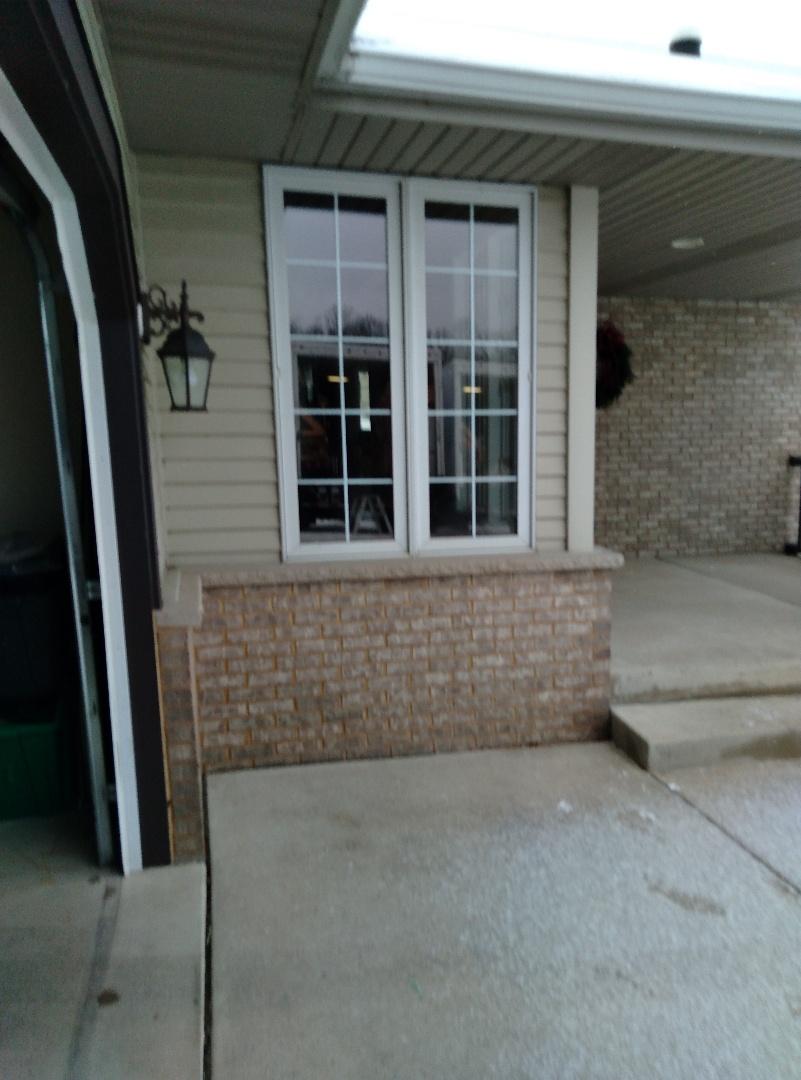 Menomonee Falls, WI - Five windows and a patio door slab with woodwork