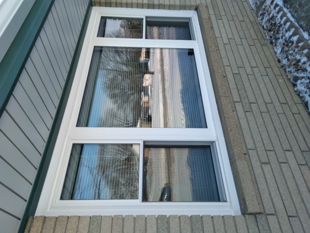 Greenfield, WI - Ten windows full frame with woodwork and aluminum trim