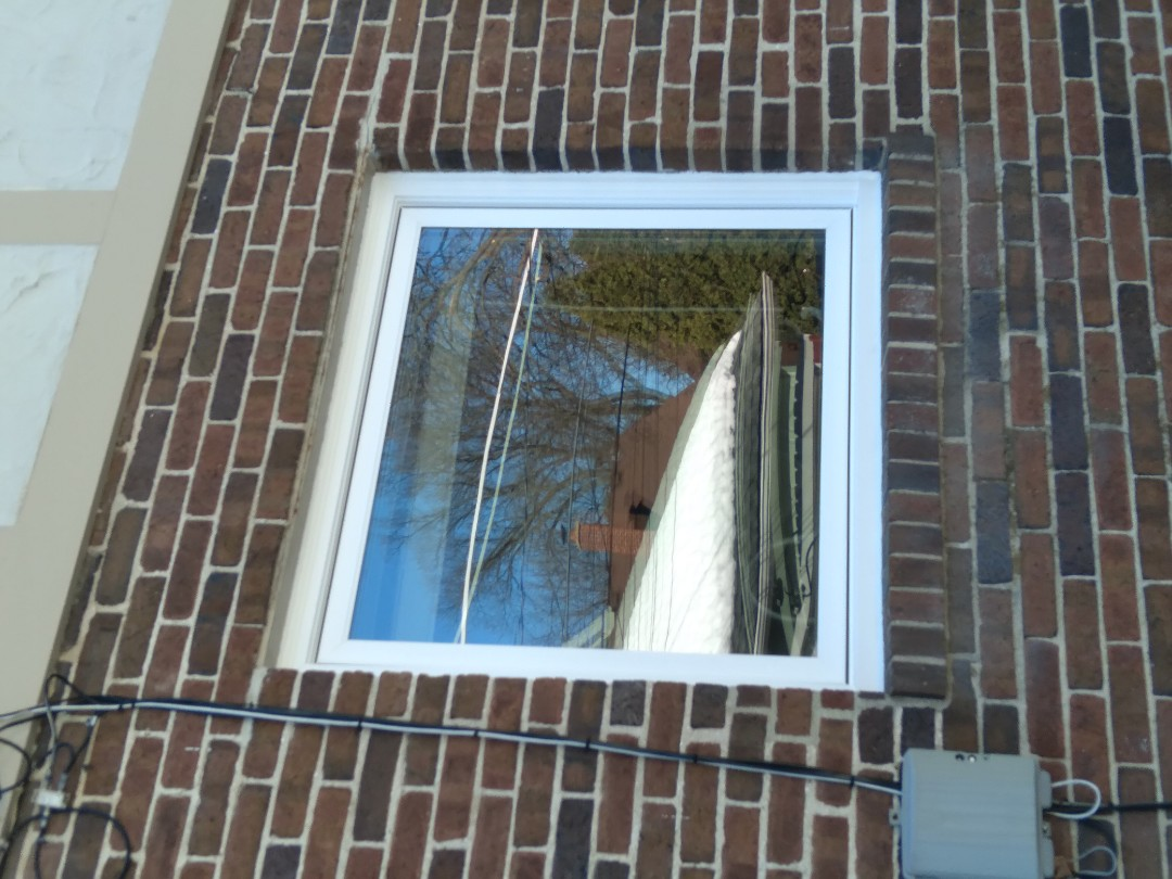 Wauwatosa, WI - One window full frame with woodwork and vinyl brickmold