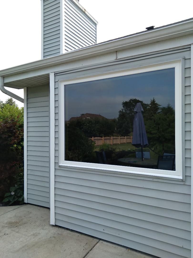 Oak Creek, WI - One window full frame with woodwork and aluminum trim