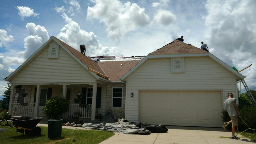 Franklin, WI - Inspecting roofing job.