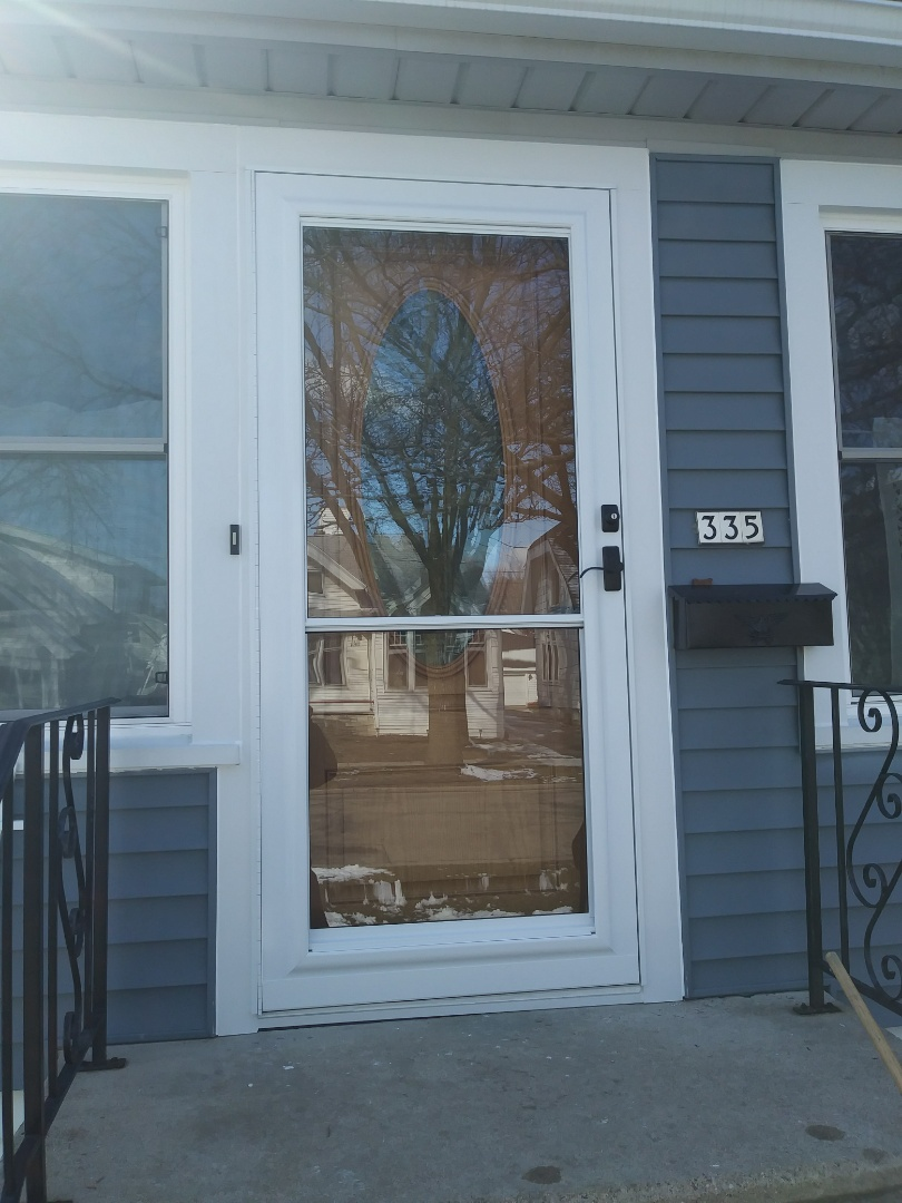 Wauwatosa, WI - Entry door and a picture window