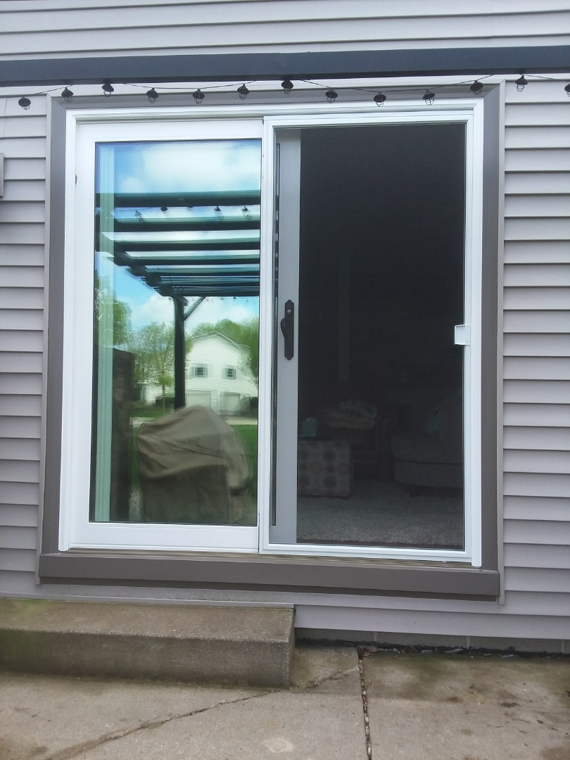 Franklin, WI - 5 double hung windows and a patio door,Day 2