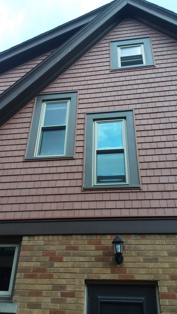 Wauwatosa, WI - Seven windows pocket install with aluminum trim and no woodwork.