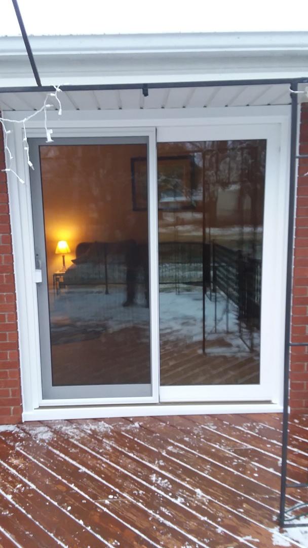 Oak Creek, WI - Installing patio door