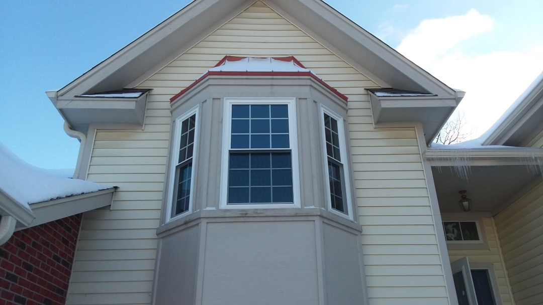 Greenfield, WI - 7 double hung windows and a patio door