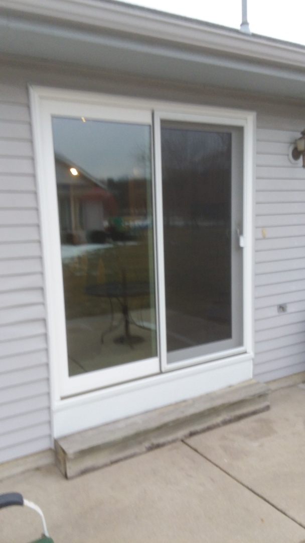 Waukesha, WI - Patio door and a storm door