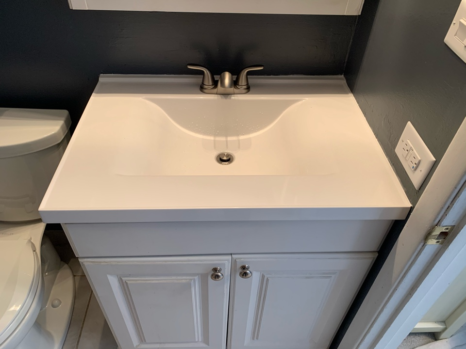 Bathroom facelift. New vanity top and faucet new comfort height Kohler toilet and updated brushed nickel tub trim