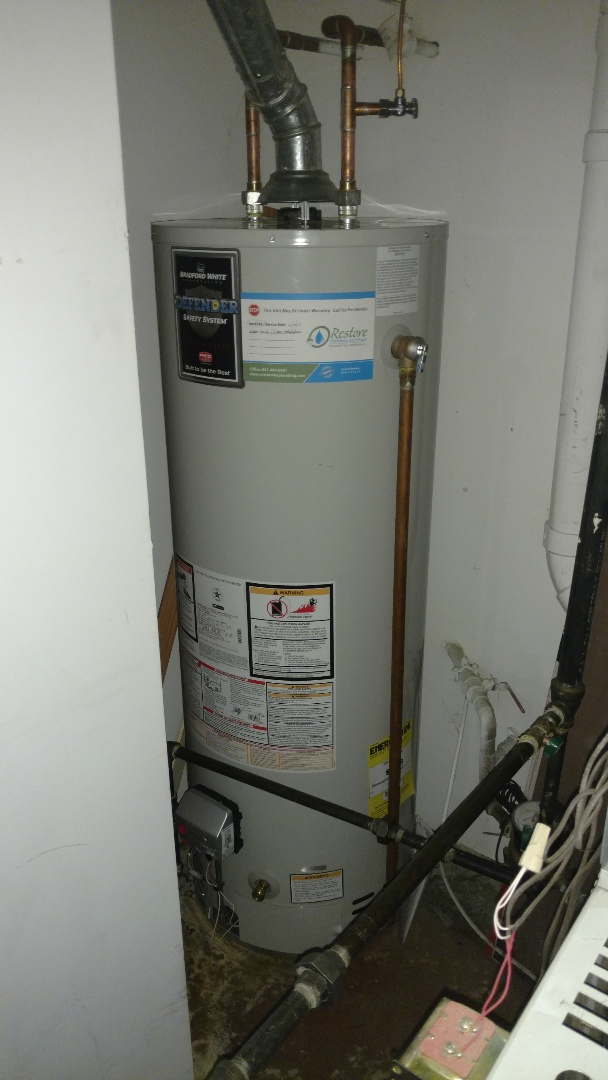 Replacement of a leaking water heater in a tight space.