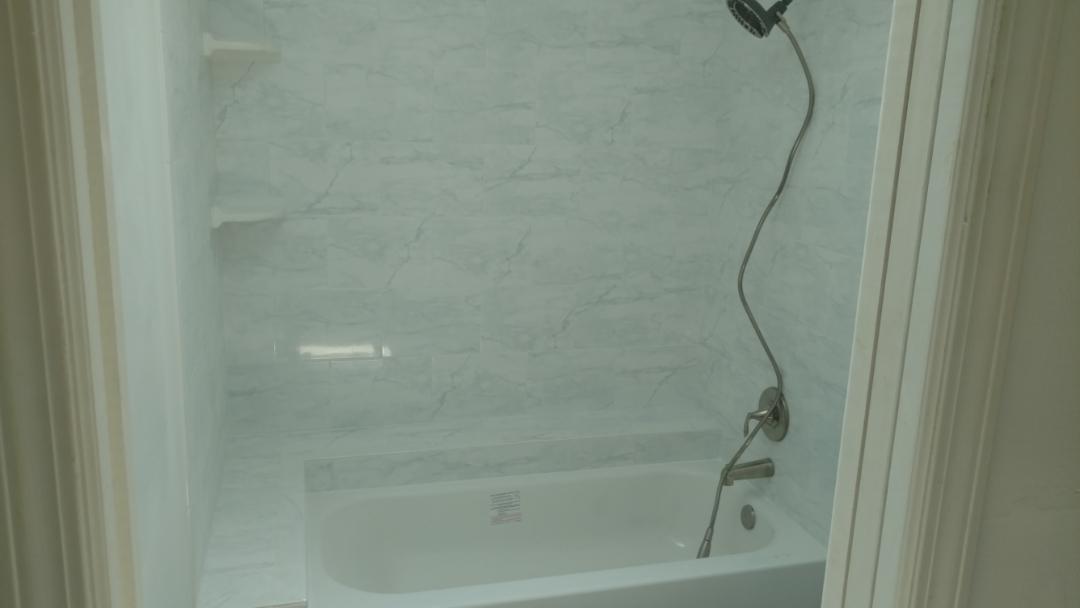 Remodel bathtub and tile enclosure.