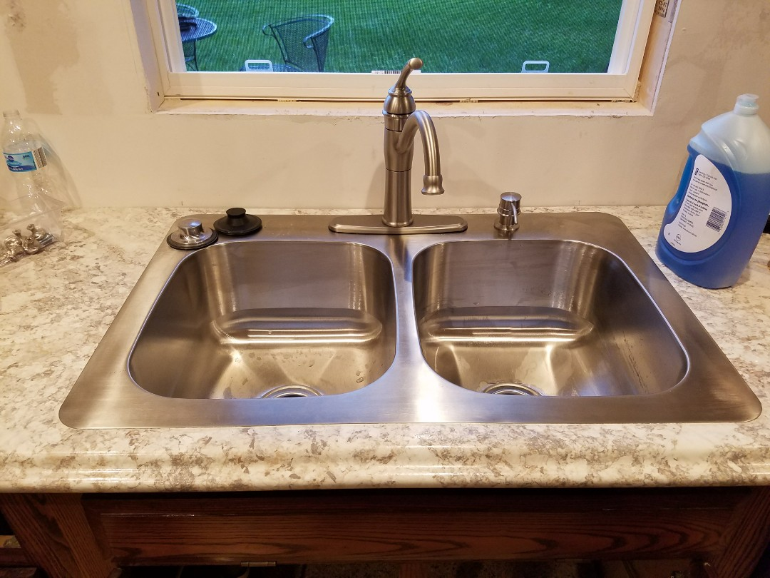 Updated older kitchen sink, faucet and garbage disposal for a fresh look.