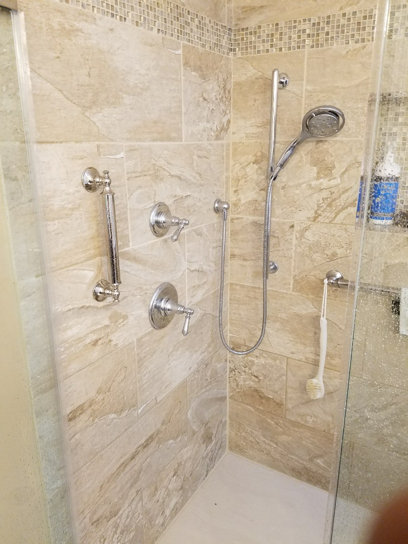 Installed grab bars to make the customer's shower more accessible.