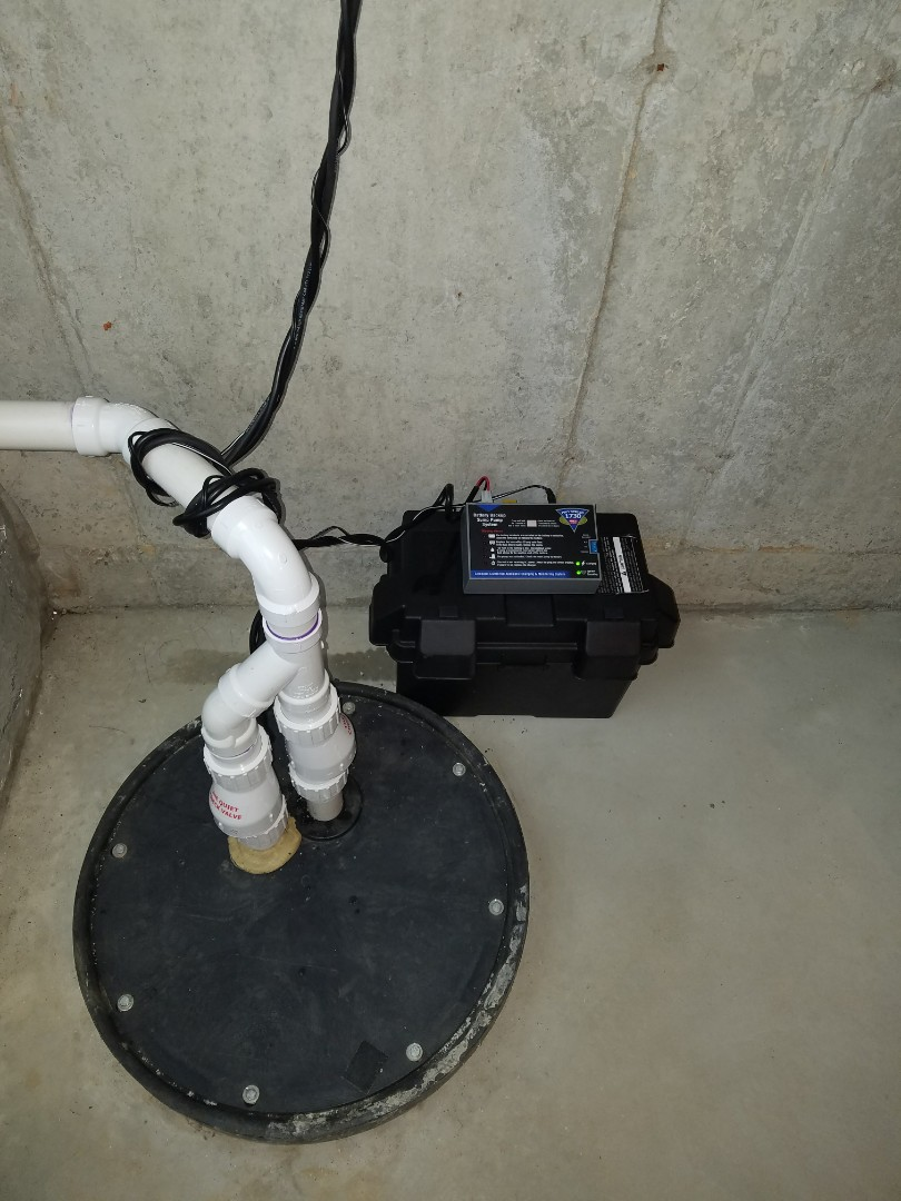 Carpentersville, IL - Replace an existing sump pump and install a new battery backup system to prevent flooding of the basement.