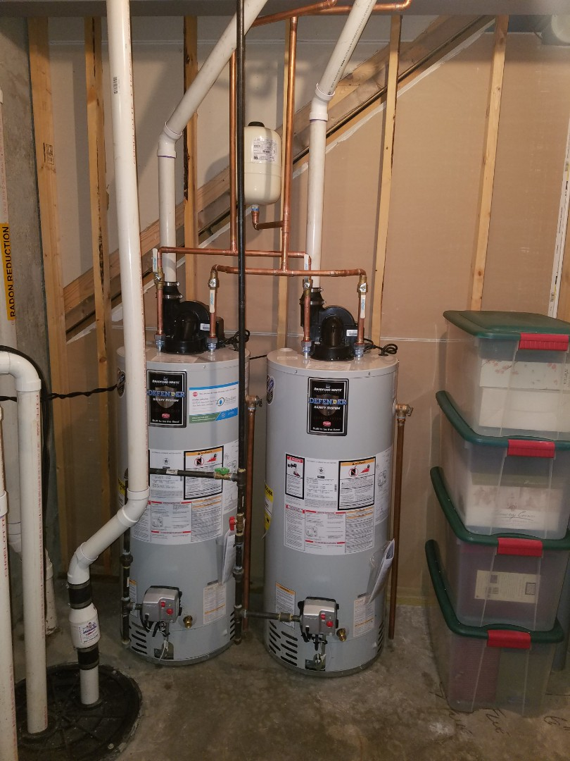 Replace water heaters due to leaks and reconfigure the system properly for more efficient function.