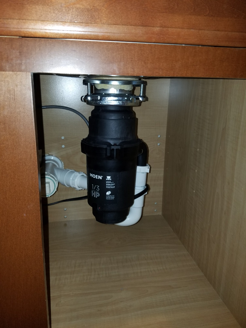 Elgin, IL - Install a new garbage disposal for the kitchen sink.