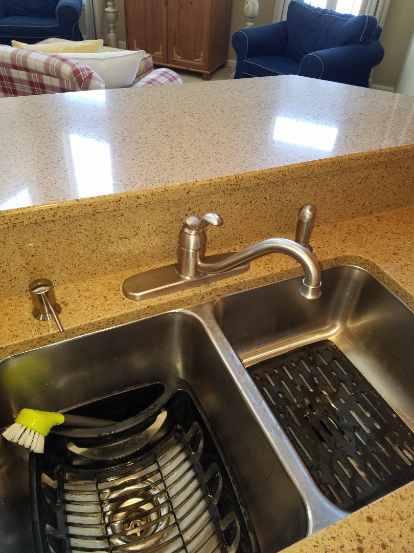 Gilberts, IL - Replace a leaking kitchen faucet and install a new soap dispenser.