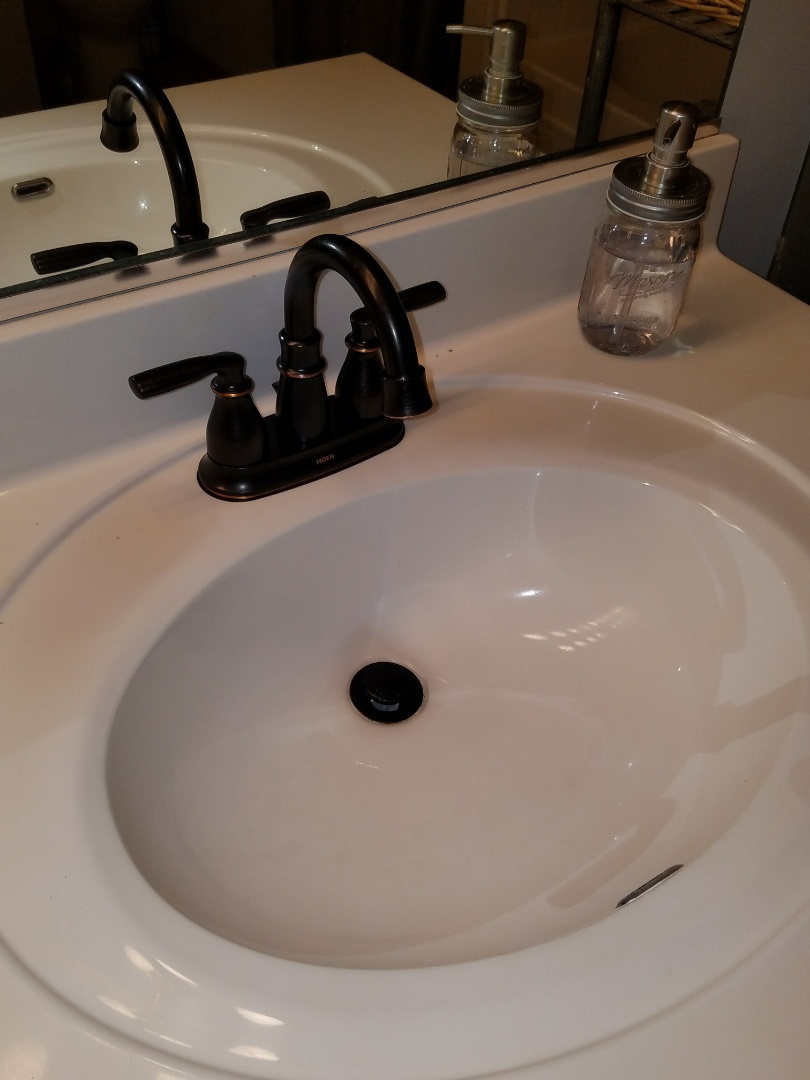 Replace older faucets with new fixtures to update the look of the bathroom.