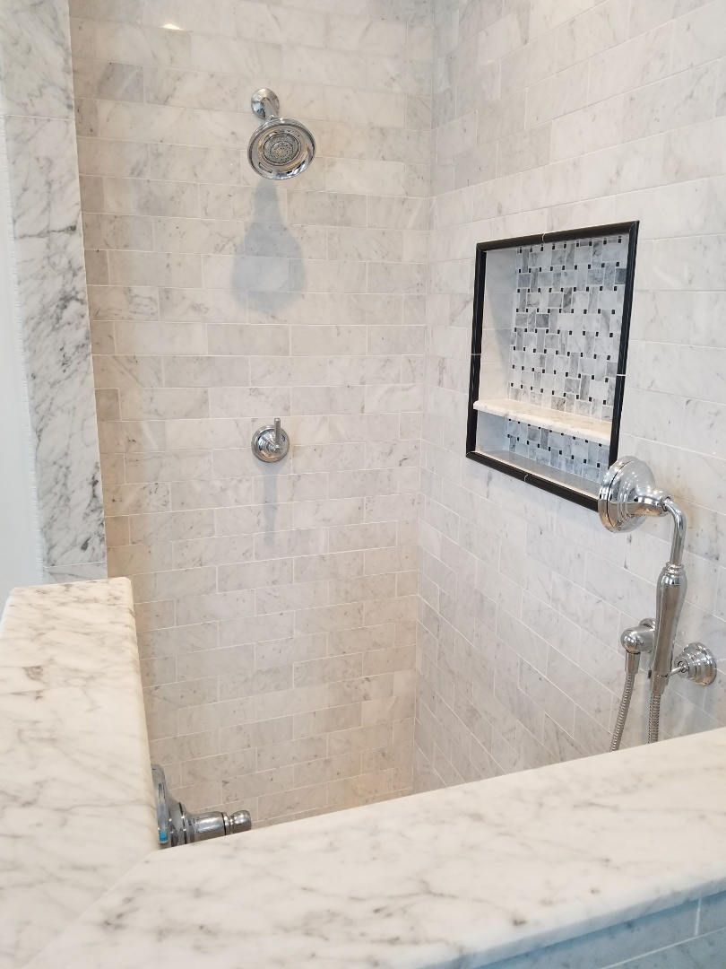 Evanston, IL - Complete a bathroom renovation to update all materials and fixtures.