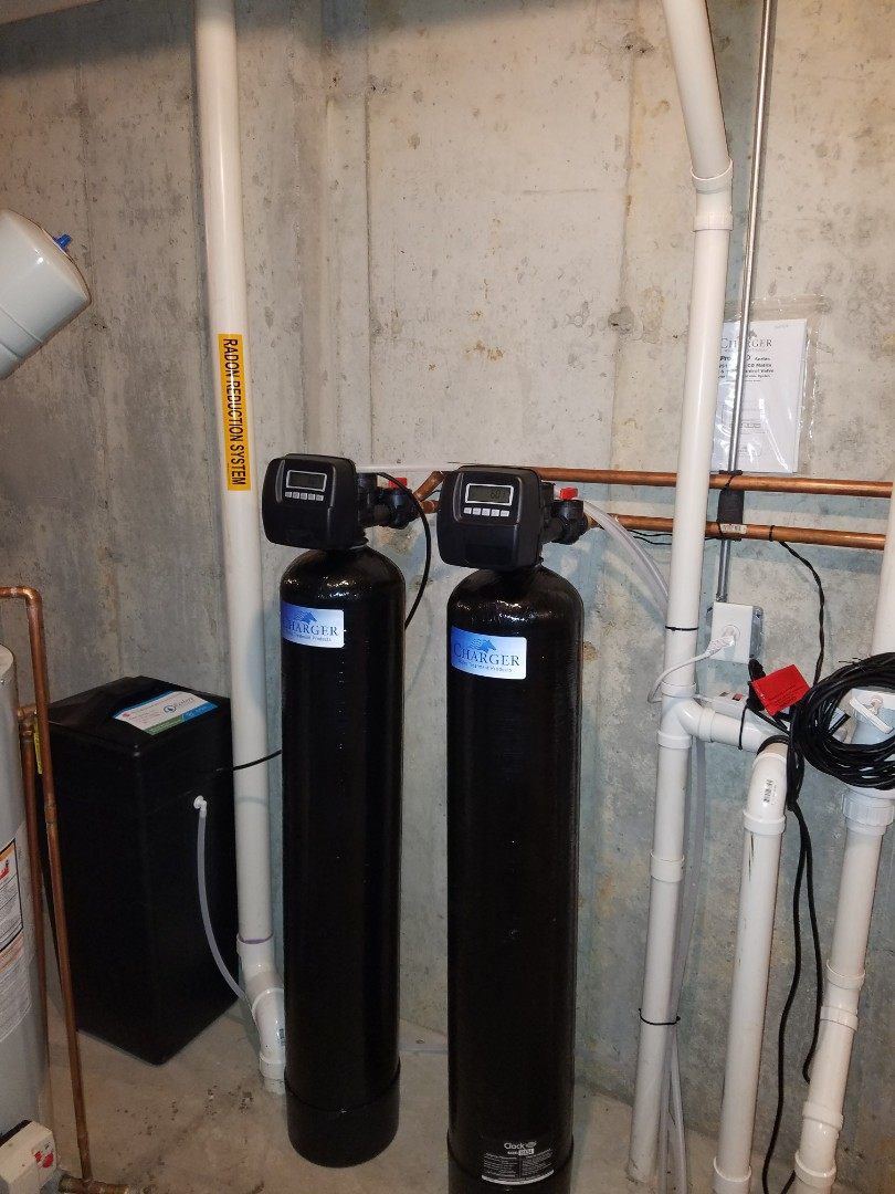 Install a new water softener and whole house carbon filter to improve the quality of water to the home.