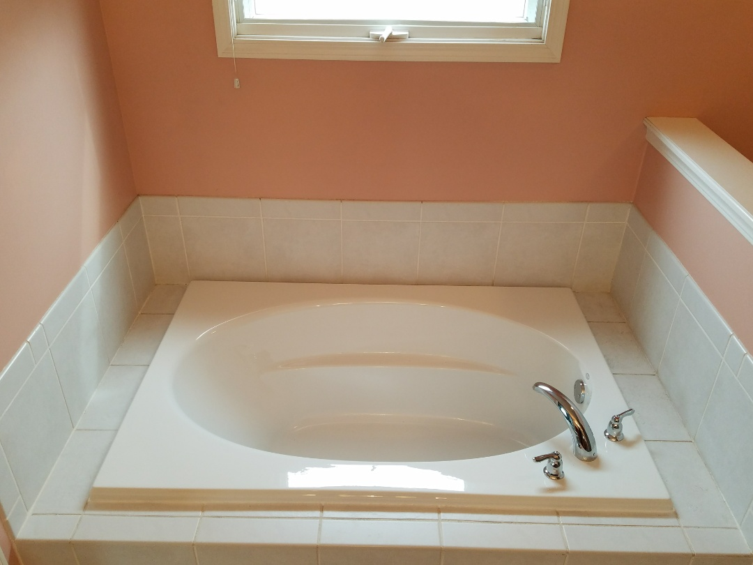 Installed a new soaker bathtub with matching Moen faucet to prevent further leaks into the ceiling below.