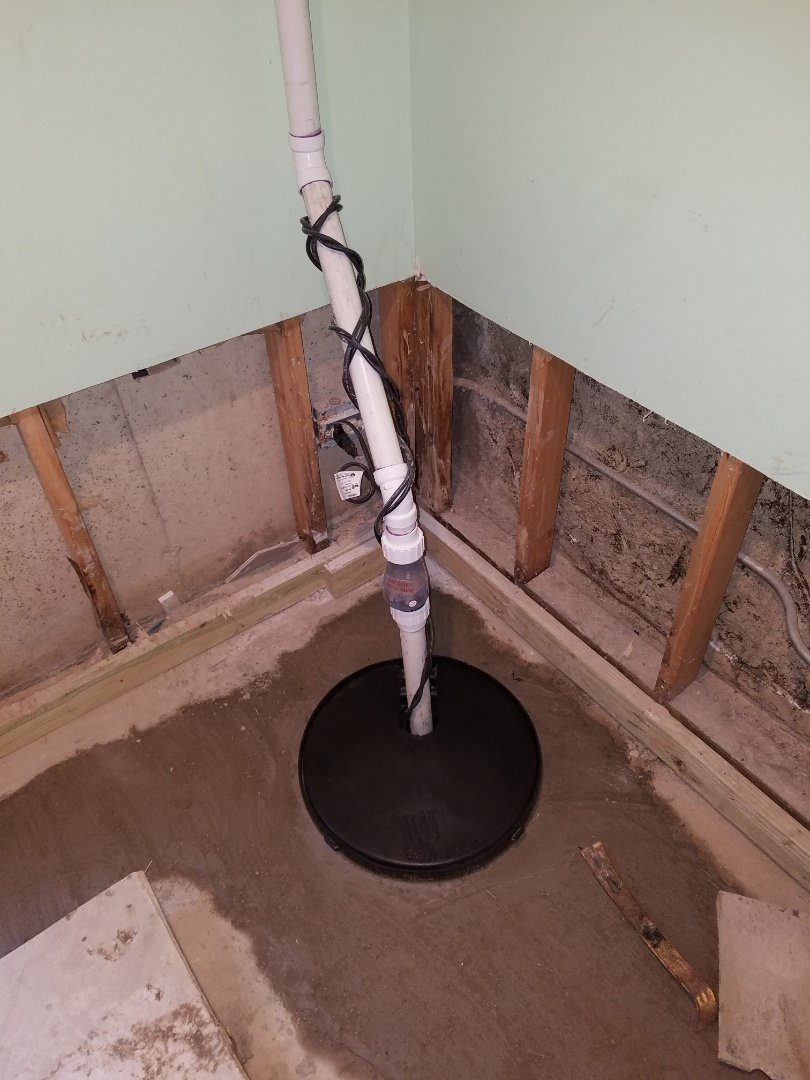 Install new drainage tile pipe and a new sump pump system to prevent further flooding in the basement.