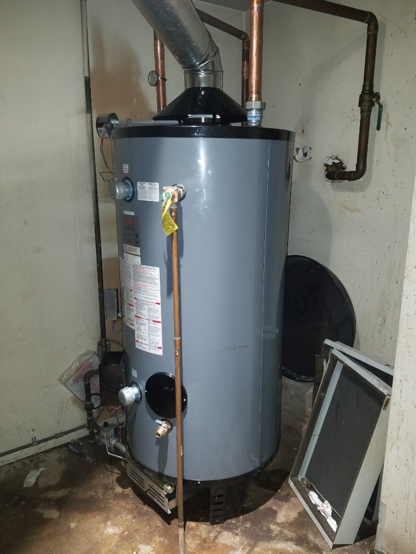 Elgin, IL - Replace a commercial water heater that was leaking through to the floors below.
