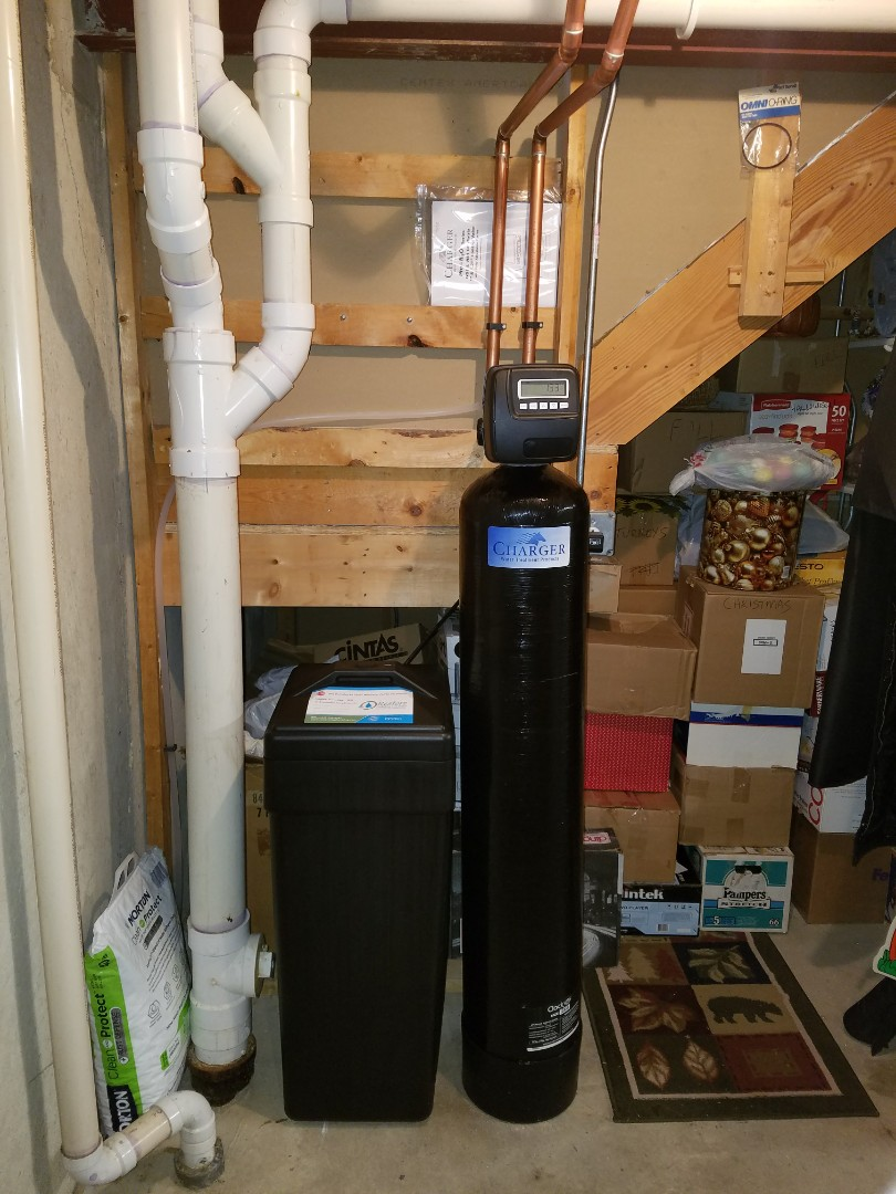 Replace an older water softener with a high efficiency system that will reduce salt consumption and provide better quality water supply to the home.