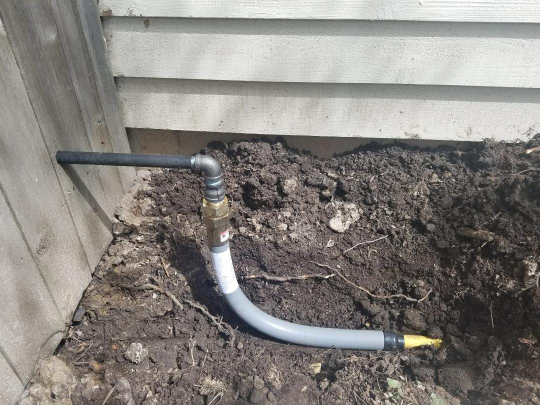 Repair a corroded and leaking gas pipe feeding the pool heater with proper connections.