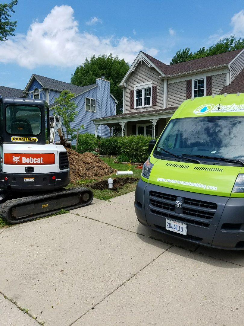 Excavate a sewer pipe and install a new clean out for maintenance access to prevent future backups.