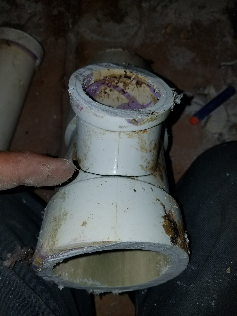 Cut out and repair a section of sewer pipe, in the wall, to remove a cracked transfer fitting that was actively leaking.