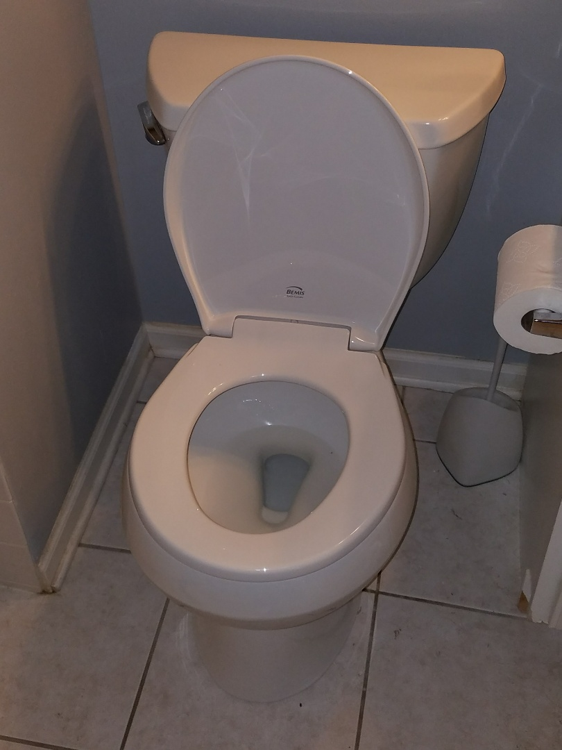 Replace an older toilet that was leaking into the ceiling below.
