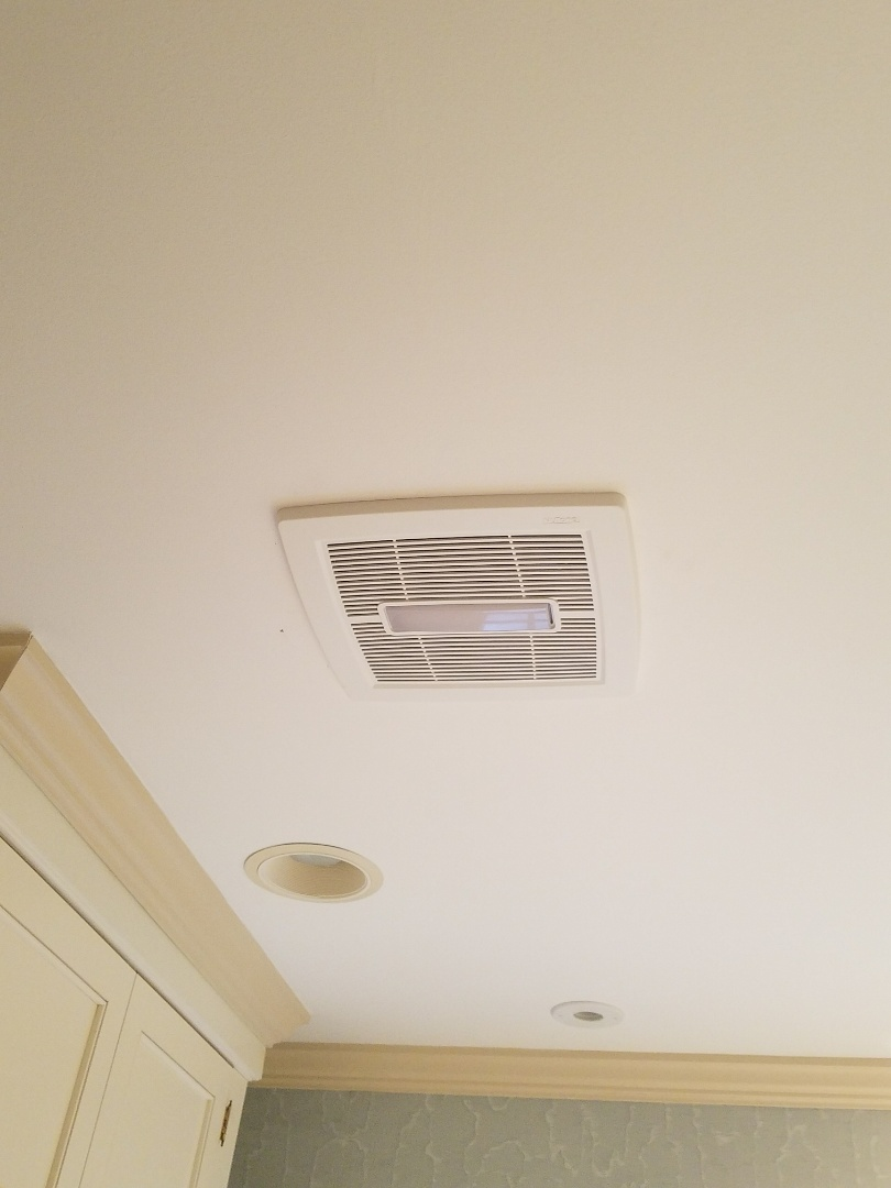 Relocate a drain's vent connection to allow clearance for a new exhaust fan in the bathroom ceiling.