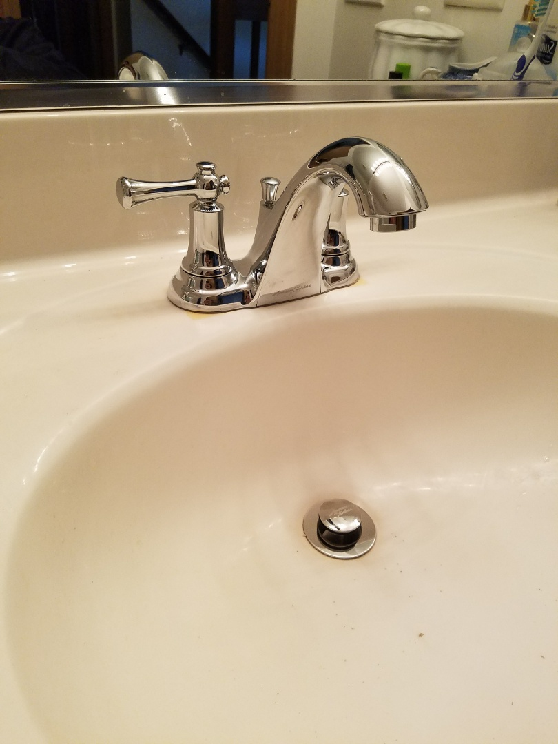 Install a new bathroom faucet and make additional repairs to the toilets to prevent further leaks.
