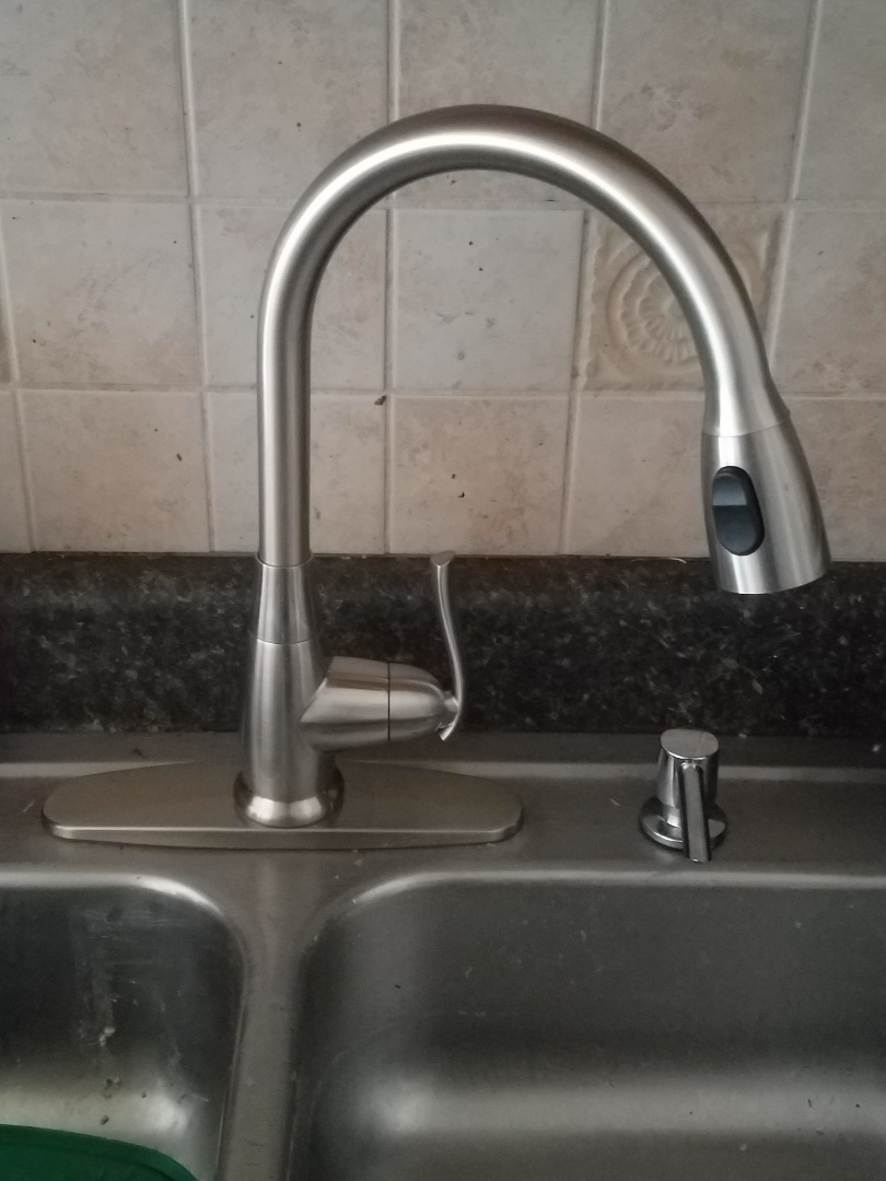 Elk Grove Village, IL - Replaced an older kitchen faucet that was leaking into the cabinet. Also repaired the drain assembly due to a seized garbage disposal.