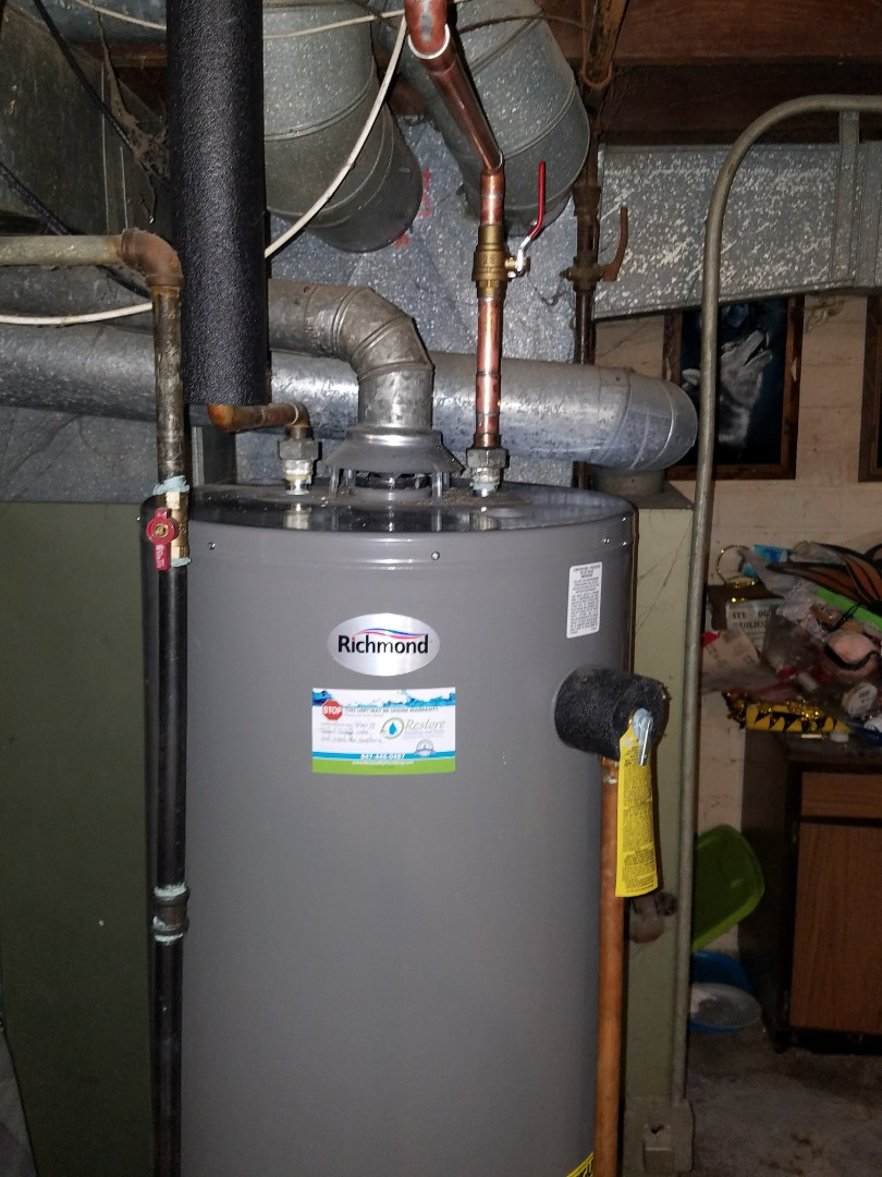 Elgin, IL - Make repairs to a water heater and a kitchen sink in order to gain code compliance.